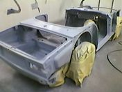 Car body being painted